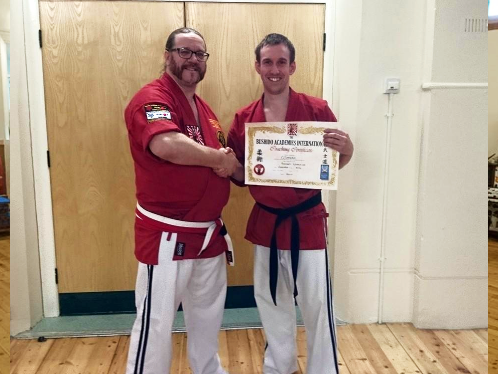Sensei John Congratulates Sensei Gareth on his Shodan