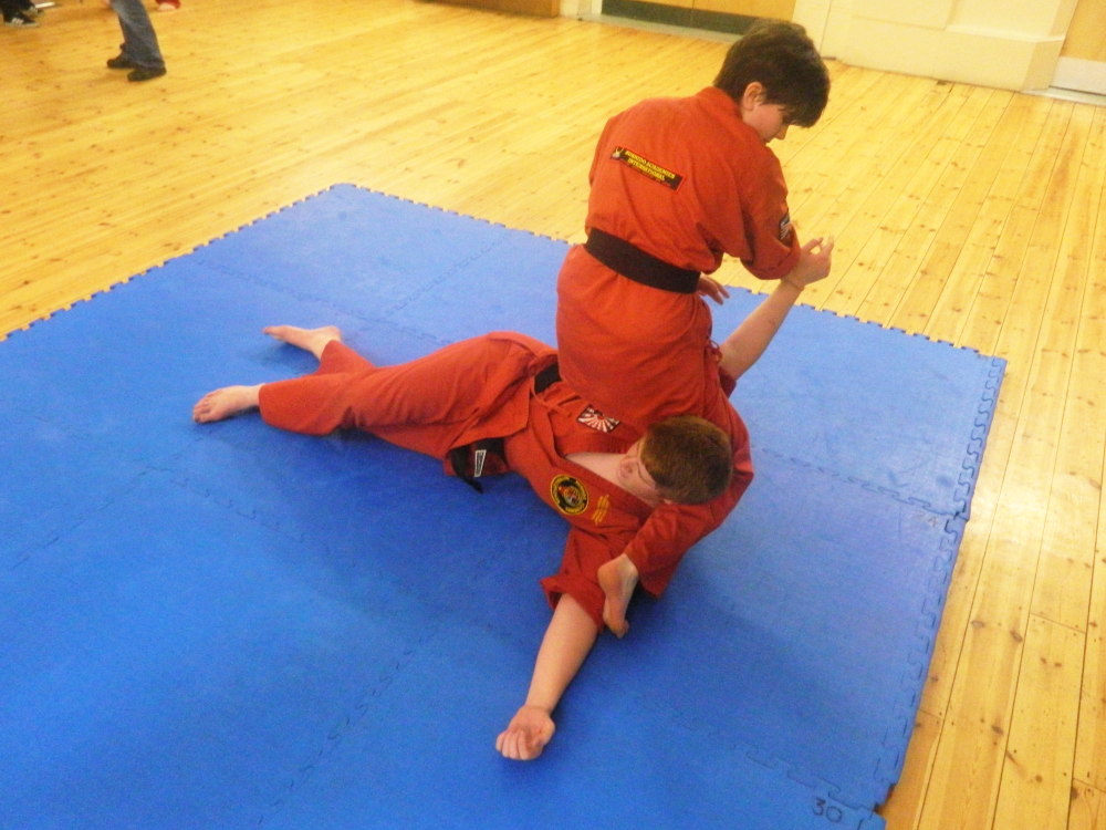 Jodie performs a shoulder lock on Jack